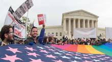 Protesters hold a pro-gay rights flag outside the U.S. Supreme Court on April 25, 2015, countering the demonstrators who attended the March For Marriage in Washington, D.C. The Supreme Court meets on April 28 to hear arguments whether same-sex couples have a constitutional right to wed in the United States, with a final decision expected in June. (PAUL J. RICHARDS/AFP/Getty Images)