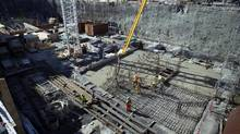 Construction crews work on a condo development in False Creek area of Vancouver, British Columbia, Canada, on Wednesday, August 7, 2013. (Ben Nelms/Bloomberg)