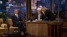 """President Barack Obama smiles while Jay Leno talks with executive producer Debbie Vickers during a break in taping on """"The Tonight Show with Jay Leno"""" in Burbank, Calif., Oct. 24, 2012. (DAMON WINTER/NYT)"""