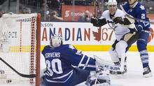 Pittsburgh Penguins' Pascal Dupuis (centre) celebrates his game tying goal after scoring Toronto Maple Leafs goaltender Ben Scrivens (left) as Maple Leafs' James van Riemsdyk looks on during third period NHL hockey action in Toronto on Thursday March 14, 2013. (CP)