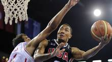 USA's Derrick Rose, right, goes up for a shot as Iran's Hamed Ehadadi defends during the preliminary round of the World Basketball Championship, Wednesday, Sept. 1, 2010, in Istanbul, Turkey. (AP Photo/Mark J. Terrill (Mark J. Terrill)
