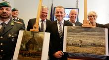 Director of Amsterdam's Van Gogh Museum Axel Ruger (C) poses next to paintings by the Dutch artist Vincent Van Gogh, that was stolen in Amsterdam 14 years ago, during a news conference in Naples September 30, 2016. (CIRO DE LUCA/REUTERS)