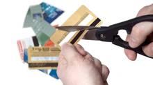 Cutting goldcreditcard (iStockphoto)