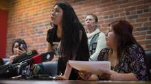 Lorelei Williams, left, speaks as Fay Blaney, right, listens during a Coalition on Missing and Murdered Indigenous Women and Girls news conference in Vancouver on April 3, 2017. (DARRYL DYCK/THE CANADIAN PRESS)