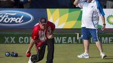 Canada's Ryan Bester, left, rolls his bowl as he plays Scotland's Darren Burnett at the Commonwealth Games in Glasgow, Scotland on Friday, August 1, 2014. (Andrew Vaughan/THE CANADIAN PRESS)