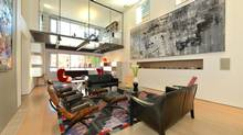"""Home of the Week, 21 Boswell Ave., Toronto. Asking price: $5.95-million. The design by Lynn Appleby is contemporary, but the plan behind the glass and steel is actually traditional. 'It's a classic Georgian home – though it's a modern loft version of it,"""" says owner Alan Saskin. The family enjoys gathering in the great room, where they can set up tables that accommodate 45 people for dinner. The 50-foot-long room has ceilings 17 feet high. (Tomasz Majchercyk)"""