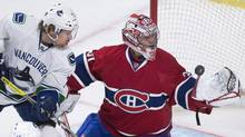 Montreal Canadiens' goaltender Carey Price makes a save against Vancouver Canucks' David Booth during third period NHL hockey action in Montreal on Feb. 6, 2014. (Graham Hughes/THE CANADIAN PRESS)