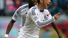 Vancouver Whitecaps' Russell Teibert, right, and Gershon Koffie, of Ghana, celebrate Teibert's first goal against the Los Angeles Galaxy during the second half of an MLS soccer game in Vancouver, B.C., on Saturday May 11, 2013. (DARRYL DYCK/THE CANADIAN PRESS)