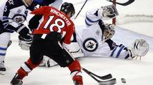 Ottawa Senators' Jesse Winchester (C) is denied a scoring chance by Winnipeg Jets' Mark Stuart and goalie Ondrej Pavelec during the second period of their NHL hockey game in Ottawa October 20, 2011. (BLAIR GABLE/REUTERS)
