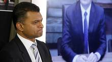 Nitin Kawale, left, president of Cisco Canada, is joined via teleconference by Rob Lloyd, Cisco's president of development and sales, during a news conference in Toronto, March 5, 2014. (Fernando Morales/The Globe and Mail)