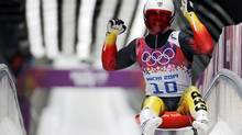 Germany's Felix Loch celebrates after completing his final run in the men's singles luge competition at the 2014 Sochi Winter Olympics on Feb. 9, 2014. (Fabrizio Bensch/Reuters)