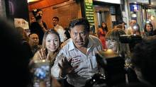 Former massage parlour tycoon-turned-politician and candidate for the Rak (Love) Thailand party Chuvit Kamolvisit strikes a pose as he tours Bangkok's red-light district of Patpong as part of his electoral campaign late on June 21, 2011. (CHRISTOPHE ARCHAMBAULT/AFP/Getty Images)