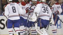 Montreal Canadiens celebrate after defeating the New York Rangers 3-2 in overtime in Game 3 of the NHL hockey Stanley Cup playoffs Eastern Conference finals on May 22 in New York. (Kathy Willens/AP)