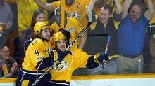 Predators teammates Filip Forsberg (left) and Viktor Arvidsson celebrate after an empty net goal during the third period against the Chicago Blackhawks in Game 4. (Christopher Hanewinckel/USA Today Sports)