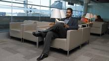 Professor Ray Jayawardhana, Canada Research Chair in Observational Astrophysics at U of T, photographed while reading in the lounge at the Porter terminal at Billy Bishop Airport in Toronto on July 15 2011. (Fernando Morales/Fernando Morales/The Globe and Mail)