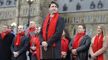 Prime Minister Justin Trudeau wears a scarf from the Red Scarf Project for AIDS awareness in Ottawa on Dec. 1, 2016. (Justin Tang/THE CANADIAN PRESS)