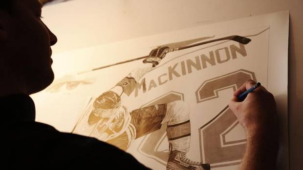 Sports artist Robb Scott works on a drawing of Nathan MacKinnon, star forward for the Halifax Mooseheads, at his home in Greenfield, N.S. (PAUL DARROW FOR THE GLOBE AND MAIL)