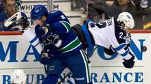 Vancouver Canucks' Yannick Weber, left, of Switzerland, and Winnipeg Jets' Chris Thorburn collide during third period NHL hockey action in Vancouver, B.C., on Sunday December 22, 2013. (DARRYL DYCK/THE CANADIAN PRESS)