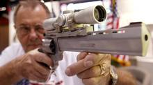Jerry L. Enders, from Naples, Florida, aims the Taurus Raging Bee Large Frame Revolver at the 132nd Annual National Rifle Association Meeting in in Orlando, Florida April 27, 2003. (SHANNON STAPLETON/Shannon Stapletonm)