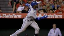 Toronto Blue Jays' Jose Reyes watches his two-run home run during the seventh inning of a baseball game against the Los Angeles Angels in Anaheim, Calif., Tuesday, July 8, 2014. (Chris Carlson/AP)