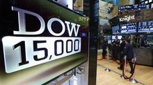 A television screen displays a logo for the Dow Jones Industrial average surpassing 15,000 during trading day on the floor at the New York Stock Exchange, May 3, 2013. Stocks climbed on Friday, with the S&P 500 and Dow industrials hitting intraday record highs after U.S. employment rose more-than-expected in April, easing concerns about weak economic growth. (BRENDAN MCDERMID/REUTERS)