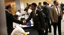 A job seeker (R) meets with a prospective employer at a career fair in New York City, October 24, 2012. (Mike Segar/Reuters)