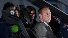 Defence Minister Peter MacKay checks out the cockpit of a F-35 Joint Strike Fighter mock-up after a procurement announcement in Ottawa on July 16, 2010. (Adrian Wyld/The Canadian Press)