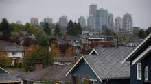 Condos in the Gilmore area of Burnaby are seen in the distance behind houses in east Vancouver, B.C. (DARRYL DYCK For The Globe and Mail)