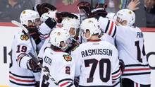 Chicago Blackhawks' Marian Hossa, centre left, of Slovakia, and his teammates celebrate his winning goal against the Vancouver Canucks during the overtime period of an NHL hockey game in Vancouver, B.C., on Saturday November 19, 2016. (DARRYL DYCK/THE CANADIAN PRESS)