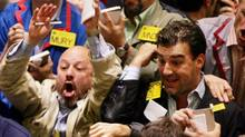 Traders at the oil pit at the New York Mercantile Exchange (Peter Morgan/Reuters)