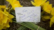 Flowers outside Lakeland Sawmill in Prince George April 25, 2012, to remember the two who died after a fire and explosion at the mill. (John Lehmann/The Globe and Mail/John Lehmann/The Globe and Mail)