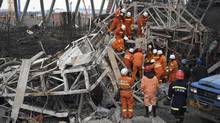 In this photo released by Xinhua News Agency, rescue workers look for survivors after a work platform collapsed at the Fengcheng power plant in eastern China's Jiangxi Province, Nov. 24, 2016. State media reported dozens were killed after the scaffolding tumbled down. (Wan Xiang/AP)