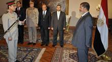 Egyptian President Mohammed Morsi swears in newly-appointed Minister of Defence Lt. Gen. Abdel-Fattah el-Sissi in Cairo on Sunday, Aug. 12, 2012. (AP)