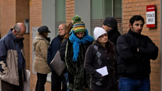 The number of people officially registered as unemployed in Spain has edged up toward 5 million as the country's recession shows few signs of abating and its struggling banks await crucial bailout cash. (Daniel Ochoa De Olza/AP)