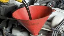 oil change for a car using a funnel (Maciej Korzekwa/iStockphoto)