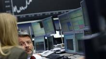 Traders are pictured in front of the German share price index DAX board at the German stock exchange in Frankfurt May 7, 2013. Germany's blue-chip DAX index hit an all-time high on Tuesday. (LISI NIESNER/REUTERS)