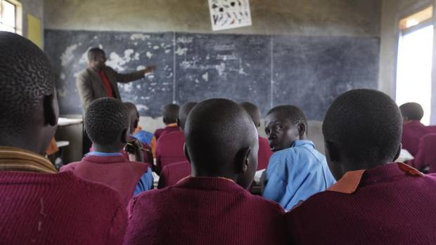 Students at Pimbiniet Primary School in Kenya's Narok South district learn about agriculture from teacher Thomas Maritim. (JOSH O'KANE/THE GLOBE AND MAIL)