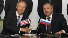 BP CEO Bob Dudley, left, and Rosneft president Eduard Khudainatov. (LUKE MACGREGOR)