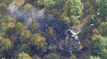 Wreckage from a corporate jet, in which former Alberta Premier Jim Prentice died, is seen after a crash into a forested area near Winfield, British Columbia, Canada October 14, 2016 in an aerial photo provided by Rob Balsdon of Castanet.net. (Rob Balsdon/Castanet.net/Handout via REUTERS)