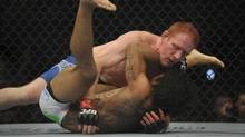 Mark Bocek fights Ben Henderson in a lightweight bout at UFC 129 at the Rogers Centre (Fred Lum/Fred Lum/The Globe and Mail)
