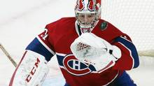 Montreal Canadiens' goalie Carey Price keeps his eyes on the puck during first period NHL hockey action against Boston Bruins in Montreal, February 6, 2013. (Christinne Muschi/REUTERS)