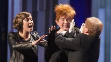 Serena Ryder (left) Dave Foley (right) and Martin Short as the puppet Leon (centre) perform a sketch at the Canadian Screen Awards in Toronto on Sunday March 9, 2014. (CHRIS YOUNG/THE CANADIAN PRESS)
