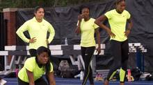 Perdita Felicien (front), Priscilla Lopes-Schliep (back left), Nikkita Holder (centre) and Phylicia George (right) warm up prior to the women's 100 metre hurdles at the Toronto International Track and Field Games in Toronto on Wednesday, July 11, 2012. (CP)