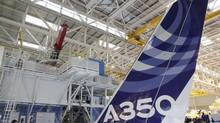 The vertical tail wing of the first Airbus A350 is seen on the final assembly line in Toulouse, southwestern France, October 23, 2012. (JEAN-PHILIPPE ARLES/REUTERS)
