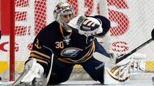 Ryan Miller of the Buffalo Sabres makes the save against the New York Islanders at the Nassau Coliseum on January 23, 2011 in Uniondale, New York. (Bruce Bennett/Getty Images)