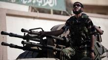 A Libyan rebel prepares to drive towards the Brega frontline from Ajdabiya to battle loyalist troops in eastern Libya on July 14, 2011 . (Gianluigi Guercia/AFP/Getty Images/Gianluigi Guercia/AFP/Getty Images)