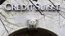 In this April 3, 2012 file picture the logo of Swiss bank Credit Suisse is photographed at a building in Zurich, Switzerland. Credit Suisse Group says it is raising 8.7 billion Swiss francs ($8.9-billion U.S.) to bolster its capital reserves. (Alessandro Della Bella/AP)