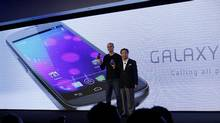 Google's top mobile executive Andy Rubin (L) and J.K. Shin, president and head of mobile communications business from Samsung, hold the new Galaxy Nexus smartphone during the news conference in Hong Kong Wednesday, Oct. 19, 2011. (Kin Cheung/AP/Kin Cheung/AP)