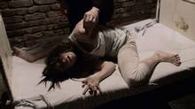 """A bent scene from """"The Devil Inside"""" (Paramount Pictures)"""