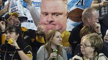 A giant-sized cutout of Toronto Mayor Rob Ford appears in the crowd as the Toronto Argonauts play against the Hamilton Tiger-Cats during CFL eastern conference final in Toronto on Sunday, Nov. 17, 2013. (Nathan Denette/THE CANADIAN PRESS)